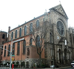 St. Anthony of Padua Church (Manhattan) - This photo shows the decorated Sullivan Street facade (right) and the plain Houston Street side, which was originally hidden by tenement buildings (left)