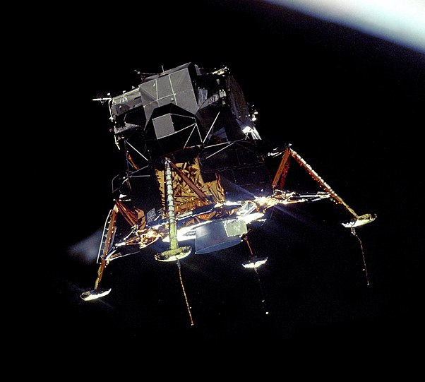 The Apollo 11 Lunar Module Eagle in a landing configuration, photographed in lunar orbit from the Command and Service Module Columbia.