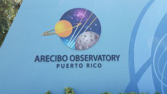 Logo of the observatory at the entrance gate Arecibo Observatory, sign at entrance gate.jpg
