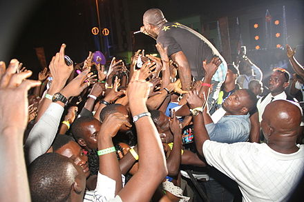 HKN's Davido entertaining the crowd at the Lagos Countdown 2012 in Nigeria Artiste Davido entertaining the crowd.jpg
