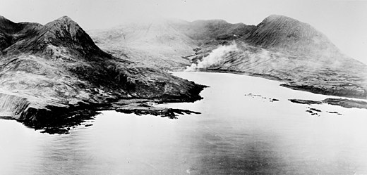 Chichagof Harbor under attack during the Allied liberation of Attu. Attu Chichagof Harbor with smoke 1943.jpg