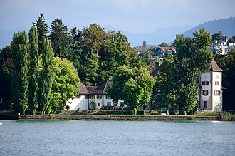Schloss Au - Schloss Au on Au Peninsula as seen from the ZSG paddle steamer ''Stadt Rapperswil''  on Zürichsee