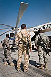 Australian and US personnel watch the unloading of a Mi-26 chartered by the ADF in Afghanistan during 2011.jpg