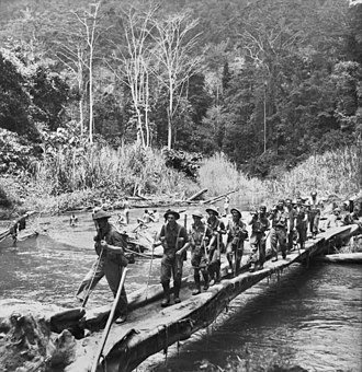2/25th Battalion (Australia) - Men from the 2/25th and 2/33rd Battalions cross the Brown River during a patrol in October 1942