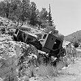 Autowrak van een pantservoertuig op een helling langs de kant van de weg, Bestanddeelnr 255-2221.jpg