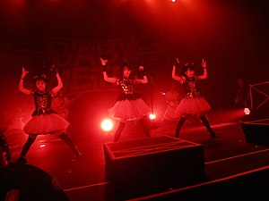 Japanese idol - Babymetal performing in Los Angeles in 2014. Their two studio albums are among the few albums by Japanese artists to make the US Billboard 200 chart.