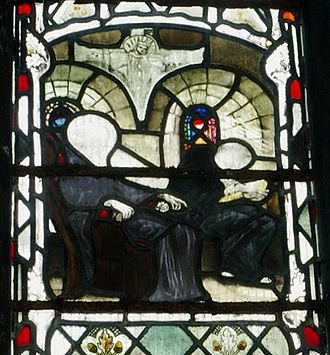 Bede - Stained glass at Gloucester Cathedral depicting Bede dictating to a scribe