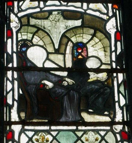 Stained glass at Gloucester Cathedral depicting Bede dictating to a scribe Bede dictating to a scribe.JPG