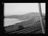 Beit Ed-Din. The Shehab Palace (held as a national monument). Ras el-Metn. Distant view. Lebanon peaks rising above cloud banks LOC matpc.15461.jpg