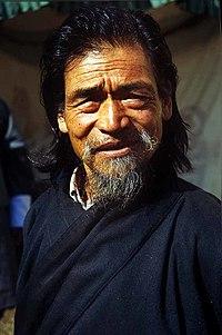 Senior Bhutanese man in national dress.