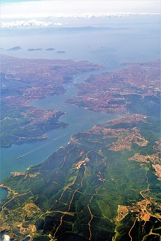Bosphorus - Aerial view of the Bosphorus taken from its northern end near the Black Sea (bottom), looking south (top) toward the Marmara, with the city center of Istanbul visible along the strait's hilly banks.