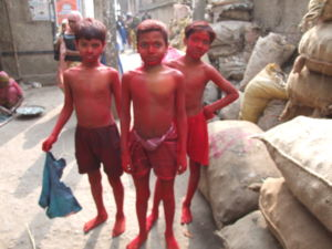 Sindoor - Boys covered with mercury-containing red vermilion chemical during child labour in a factory producing sindoor in Bangladesh