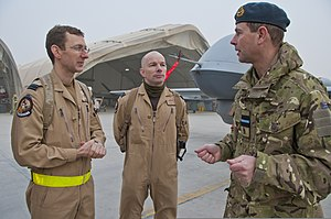 Britain's Prince Edward, right, talks with two Royal Air Force pilots while visiting the 62nd Expeditionary Reconnaissance Squadron at Kandahar Airfield, Afghanistan, Dec. 20, 2011 111220-F-XH170-520.jpg