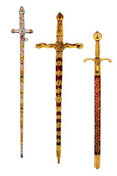 Three swords: one of gold and silver appearance covered in stones, the others red with gilded handles and decorations