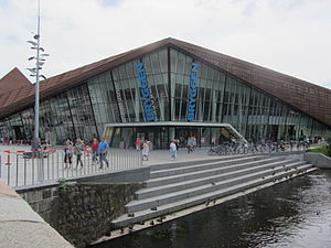"Vejle River - Bryggen (""The Wharf"") shopping centre in Vejle with steps to Vejle River"