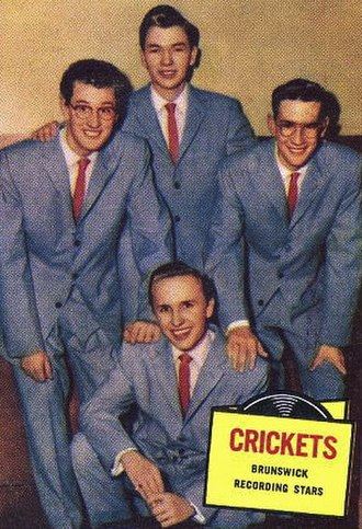 The Crickets - Trading card of the Crickets, 1957: (back row, left to right) Buddy Holly, Jerry Alison, and Niki Sullivan; (front) Joe Mauldin. Topps issued series cards featuring movie stars, television stars and recording stars. The Crickets were part of its series of recording stars cards.