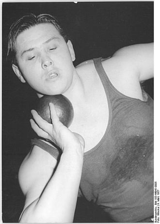 Shot put - Czechoslovak shot putter Jiří Skobla showing the correct technique for keeping the shot near the neck