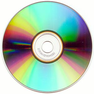 Optical disc - The bottom surface of a compact disc, showing characteristic iridescence.