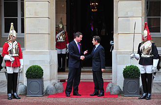 Lancaster House Treaties - David Cameron greets Nicolas Sarkozy at Lancaster House, London, for the UK-France Summit.