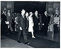 Carl Albert, Queen Elizabeth, and Nelson Rockefeller walking together, Loise Butler Washington seen behind the ropes.jpg