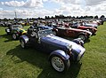 Caterham 7 Roadsters Parked On Grass.jpg