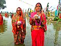 Celebrating Chhath in Kataiya, Saptari by giving Argha to Sun God.jpg