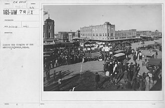 Ennis, Texas - Downtown Ennis at the corner of Ennis Ave. and W. Main St. where residents are celebrating the Armistice, marking the end of World War I. NARA Archive, recorded March 21, 1919.