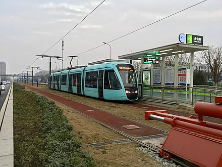 A tram in Chengdu, whose line forms a part of the Chengdu Metro. The city is one of several in China to invest in tram systems in the early 21st centry Chengdu Tram Line 2 Train at Hexin Road Station.jpg