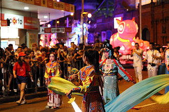 Chinese New Year celebrations in Chinatown. Sydney is home to the nation's largest population of Chinese Australians. Chinese New Year Parade in Chinatown Sydney.jpg