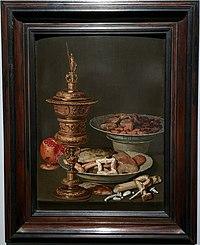 Clara Peeters - Stilleven met snoepgoed, granaatappel, vergulde beker en porselein - privécollectie.jpg