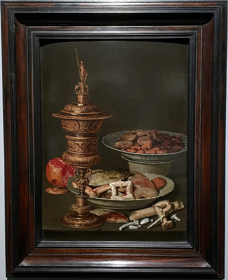 Still life with a gilt goblet, a pomegranate and Wan Li dishes with fruit, nuts and sweets, waarschijnlijk 1612