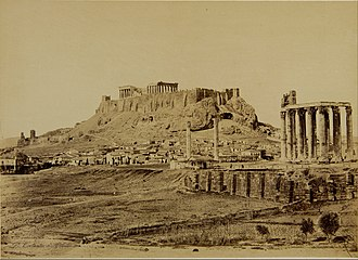 Temple of Olympian Zeus, Athens - This photograph of 1865 by Constantinou Dimitrios shows above the last two columns of the main group, a small stone structure in which had lived an ascetic or Stylite
