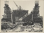 Construction of the northern piers of the Sydney Harbour Bridge, 1927 (8283756736).jpg