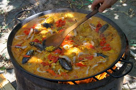 Paella, a traditional Valencian dish Cooking a paella.jpg