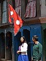 Couple with Nepalese Flag - Thamel District - Kathmandu - Nepal (13422184235).jpg