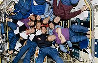 Crewmembers of STS-71, Mir-18 and Mir-19 Pose for Inflight Picture - GPN-2002-000061 rotated.jpg