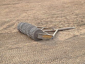 Harrow (tool) - Crumbler roller, commonly used to compact soil after it has been loosened by a harrow