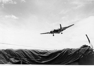 Canada and the Vietnam War - A de Havilland Canada DHC-4 Caribou transport plane on landing approach, Vietnam War, 1971.