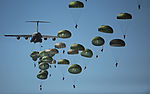 Defense.gov News Photo 110910-GO452-406 - U.S. Army paratroopers from the 82nd Airborne Division descend to the ground after jumping out of a C-17 Globemaster III aircraft over drop zone.jpg