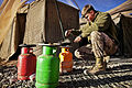 Defense.gov News Photo 120225-M-MM918-002 - U.S. Marine Corps Lance Cpl. Tom Morton cooks eggs for breakfast before beginning his duties at Patrol Base Bury in the Garmsir district of.jpg