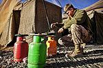 Defense.gov News Photo 120225-M-MM918-002 - U.S. Marine Corps Lance Cpl. Tom Morton cooks eggs for breakfast before beginning his duties at Patrol Base Bury in the Garmsir district of.jpg
