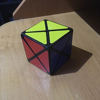 Dino Cube - The Dino cube in its second solved state, which is a mirror image of the first one.