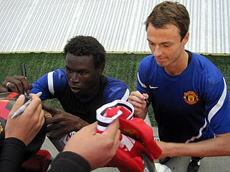 Mame Biram Diouf - Diouf and Jonny Evans signing autographs for Manchester United supporters