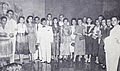 Djamaluddin Malik surrounded by Persari actresses Film Varia Nov 1953 p21.jpg