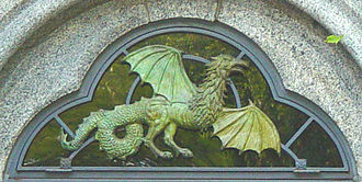 Belvedere Castle - Mould's bronze cockatrice, part of a transom over a doorway of the Castle in 2004