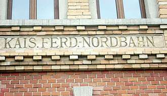 Emperor Ferdinand Northern Railway - Kaiser Ferdinands-Nordbahn inscribed in abbreviated form on the façade of the main railway station in Bielsko-Biała, Poland