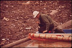 EPA Man Checks Log Boom for Leakage of Oil and Debris Following a Massive Oil Spill Into the San Juan River, 10-1972 (3814162173).jpg