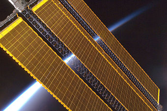 Earth horizon and International Space Station solar panel array (Expedition 17 crew, August 2008).jpg