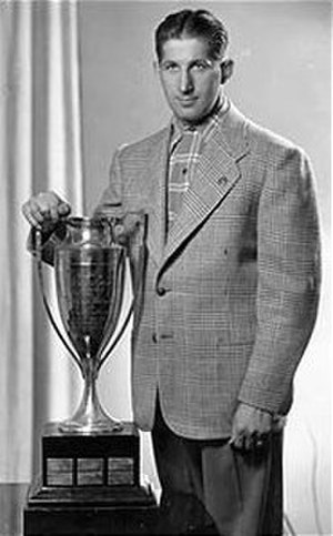 Most valuable player - Elmer Lach with the original Hart Memorial Trophy in 1945