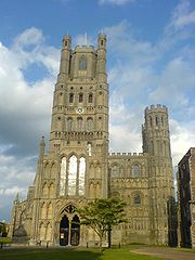 Ely Cathedral, England, had an elaborate west front with its central tower framed by smaller towers showing transitional features, 1180s. One of the smaller towers fell. Porch, 1250s; lantern, 1390s.